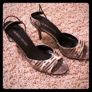 Giorgio Armani heel sandals available.